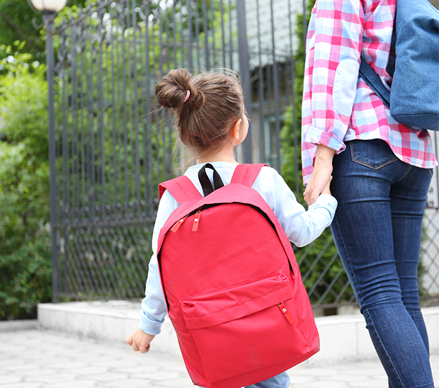 Image of a child and parent with knapsacks